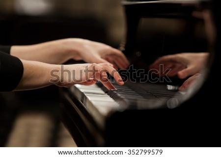 Hands girl playing piano closeup - stock photo