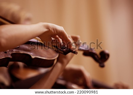 Hands girl playing the violin - stock photo