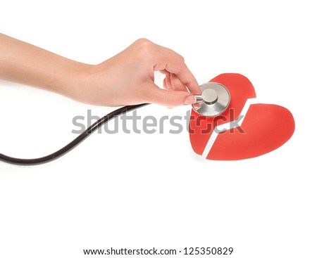 Hands girls with a stethoscope and two broken heart - stock photo
