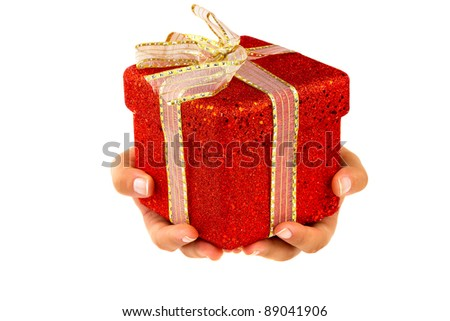 Hands giving a christmas gift isolated on white - stock photo