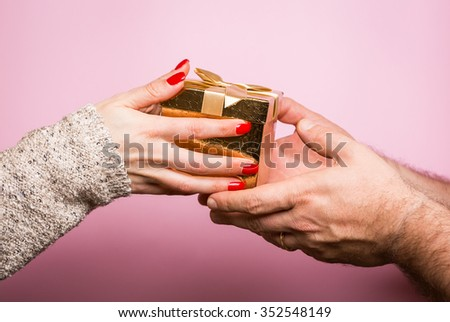 Hands giving and receiving a present - stock photo