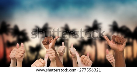 Hands giving thumbs up against digitally generated palm tree background