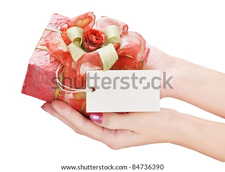 hands hold a gift in a beautiful box - stock photo