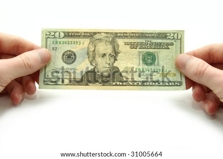 Hands hold 20 bill on white background - stock photo