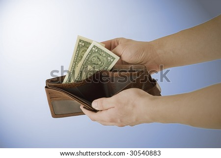 Hands hold out an wallet with money