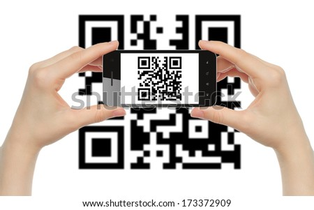 Hands hold smart phone with QR code on white background   - stock photo