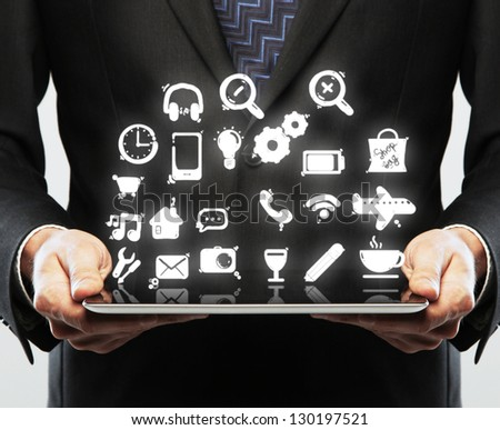 hands hold tablet with social icon - stock photo