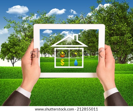 Hands hold tablet with symbols of public service and house - stock photo