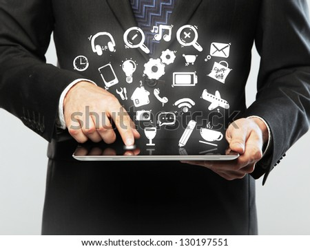 hands hold touch pad with social media icon - stock photo