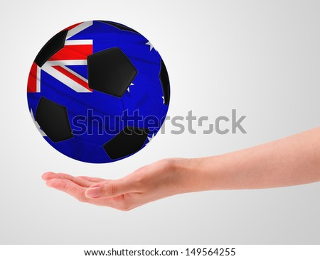 Hands holding a ball with flag of australia - stock photo