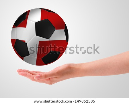 Hands holding a ball with flag of denmark - stock photo