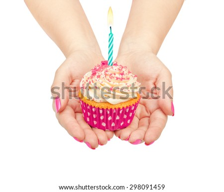 hands holding a birthday cupcake isolated on white background - stock photo