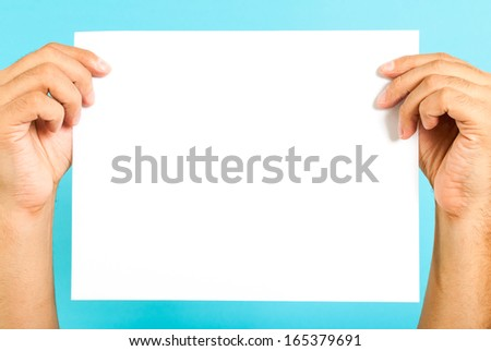 Hands holding a blank message board - stock photo