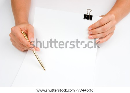 Hands holding a blank paper and golden pen - stock photo