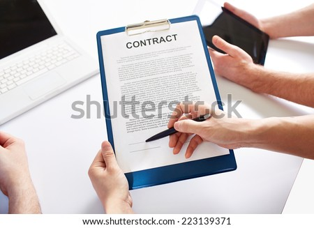 Hands holding a business contract  - stock photo