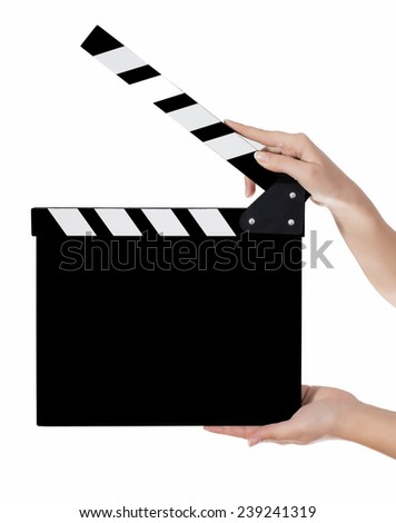 Hands holding a clapper board in white background - stock photo