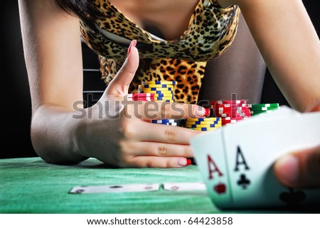 hands holding a deck of playing cards - stock photo
