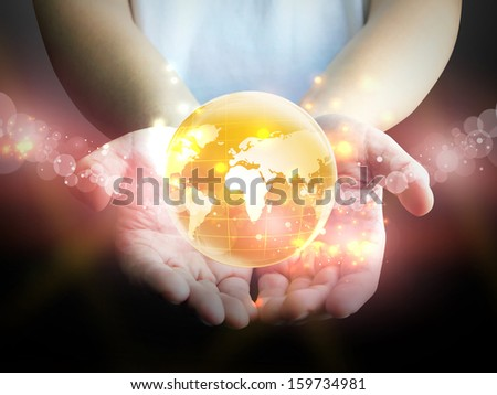 hands holding a glowing earth - stock photo