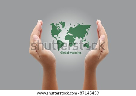 Hands holding a green earth,global warming - stock photo