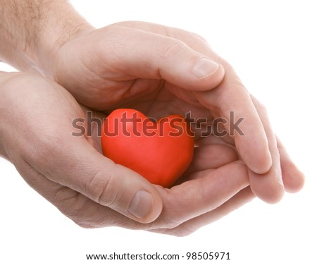 Hands holding a heart - stock photo