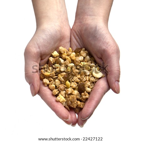 Hands holding a hollow of the cereals. Concept.