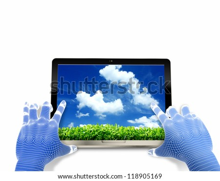 hands holding a laptop computer gadget with the image of green grass and blue sky