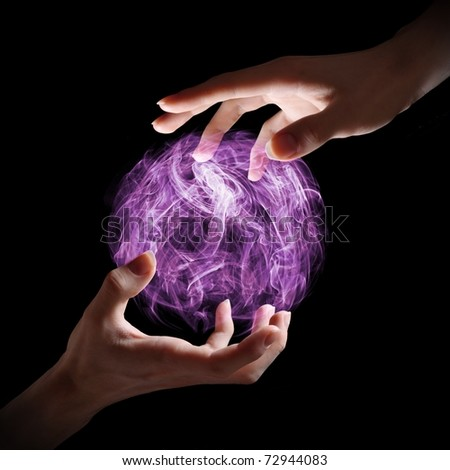Hands holding a magical orb. - stock photo