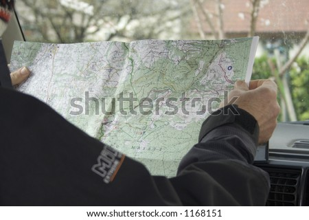 Hands holding a map - stock photo