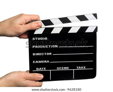 hands holding a movie clapperboard - stock photo
