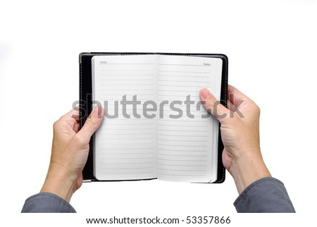 hands holding a notebook