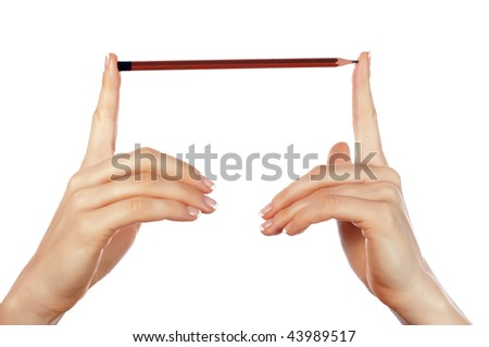 Hands holding a pencil isolated on white background - stock photo