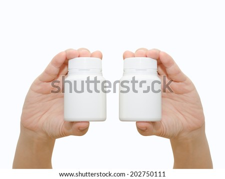 Hands holding a pill bottle isolated on white background - stock photo