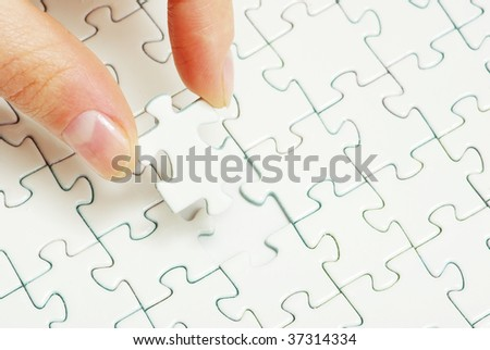 hands holding a puzzle piece