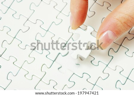 hands holding a puzzle piece . business concepts