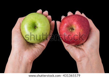 hands holding a red apple in black background - stock photo
