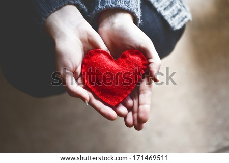 hands holding a soft heart shape