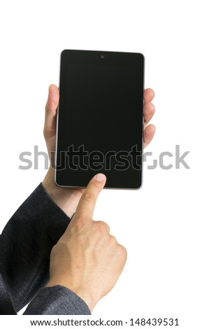 hands holding a tablet touch pad computer gadget and touches the screen - stock photo