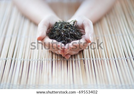 hands holding a tea on a neutral background - stock photo