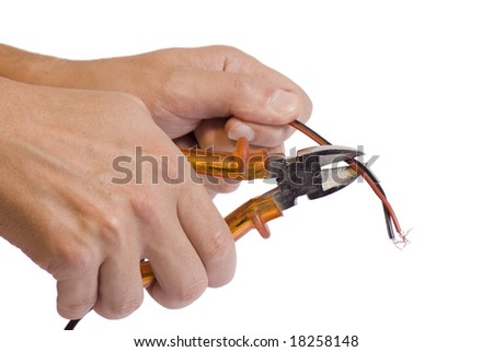hands holding a wire cutter in an isolated background