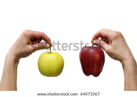 hands holding a yellow and a red apple - stock photo