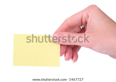 Hands holding a yellow blank notecard - stock photo