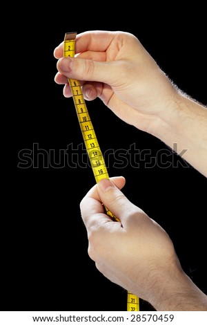 Hands holding a yellow tape measure