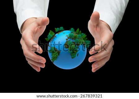 Hands holding against earth with forest