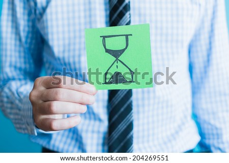 Hands holding an hourglass - stock photo