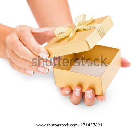 Hands holding an opened gift box isolated on white