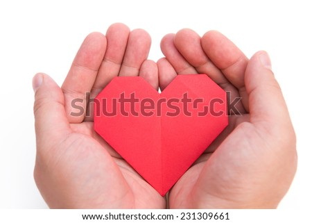 hands holding an origami heart
