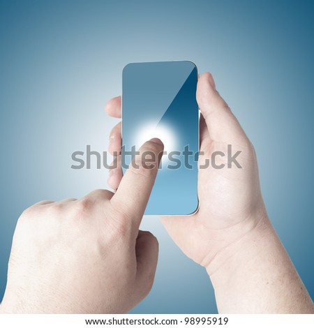 Hands holding and point on touch screen mobile phone with 3D globe icon coming from the screen on blue background - stock photo