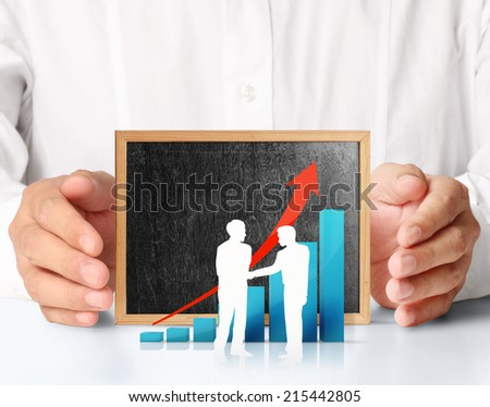 Hands holding blackboard with chart