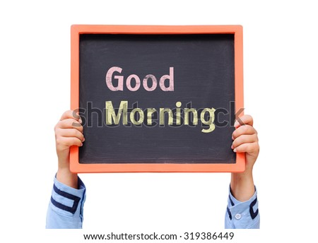 Hands holding blackboard with Good morning message - stock photo