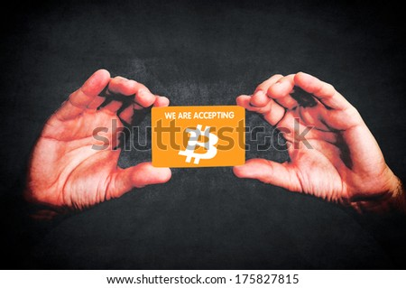 Hands holding blank calling card ion black background